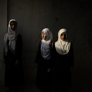 Nabila, 16, center, and Ayena, 18, at the Marshal Dostum School, where over two dozen girls from Darzab and Qosh Tepa districts study, in Sheberghan, Afghanistan, May 5, 2021. Two districts in Afghanistan's northwest offer a glimpse into life under the Taliban, who have completely cut off education for teenage girls.,Image: 611219994, License: Rights-managed, Restrictions: , Model Release: no, Credit line: KIANA HAYERI / New York Times / ContactoPhoto